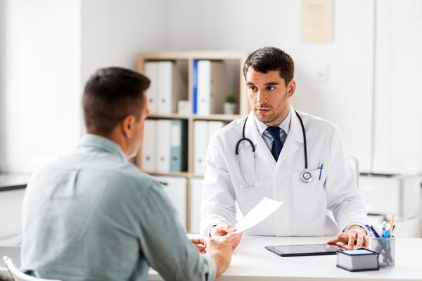 Doctor and patient discussing PTSD Treatment
