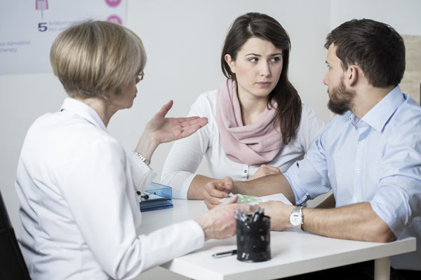 Three people at a table discussing meth addiction treatment